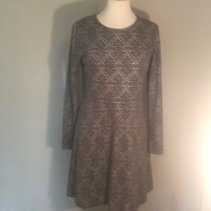 Fully lined Kenzie dress with geometric designs.